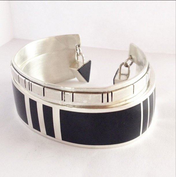 An inlay black jade and sterling silver bracelet set. Image courtesy Mariele Ivy.