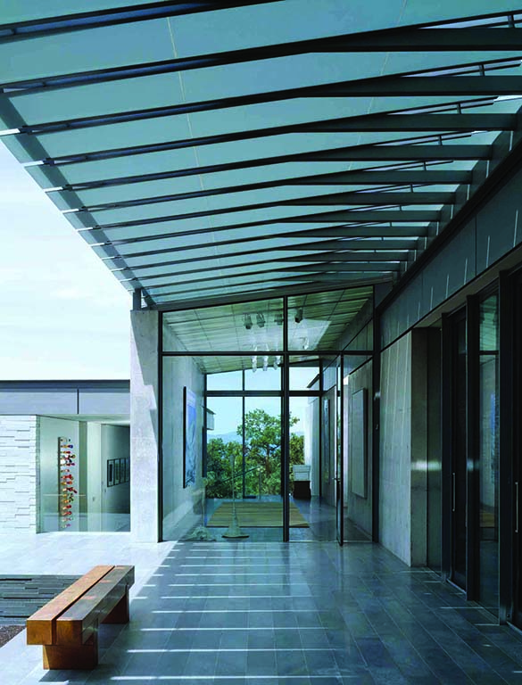 A sunshade runs the length of the house, softening sunlight and creating a modern shaded porch. Photo by David Marlow.