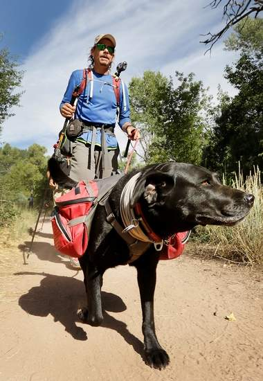 Trevor Thomas and his guide dog, Tennille, come to the end of the Colorado Trail on Thursday north of Durango. Thomas, who is blind, started his nearly 500-mile trek June 19. Photo by Jerry McBride