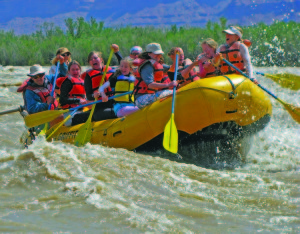 Rafting on the Colorado River through Fisher Towers.