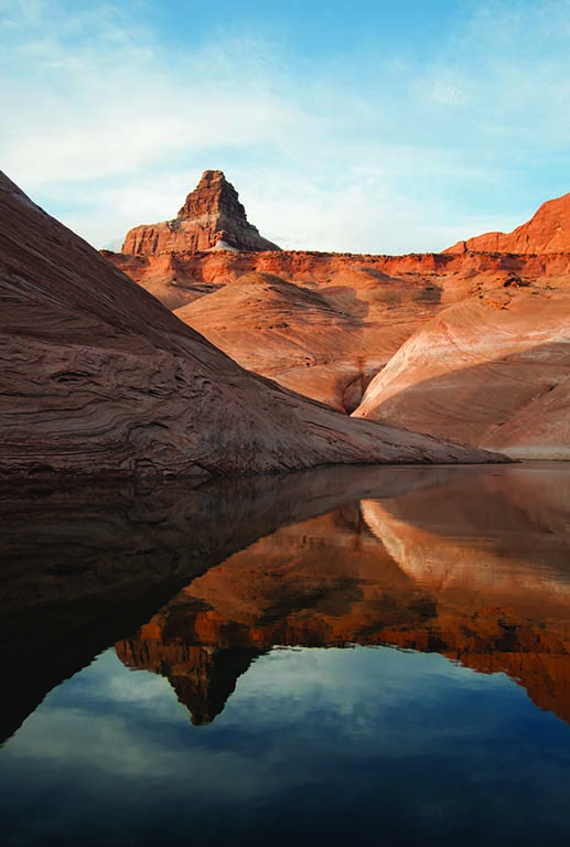 Smooth water and and storm-free afternoons make autumn a great time for paddleboarding on Lake Powell. Photo courtesy iStock.
