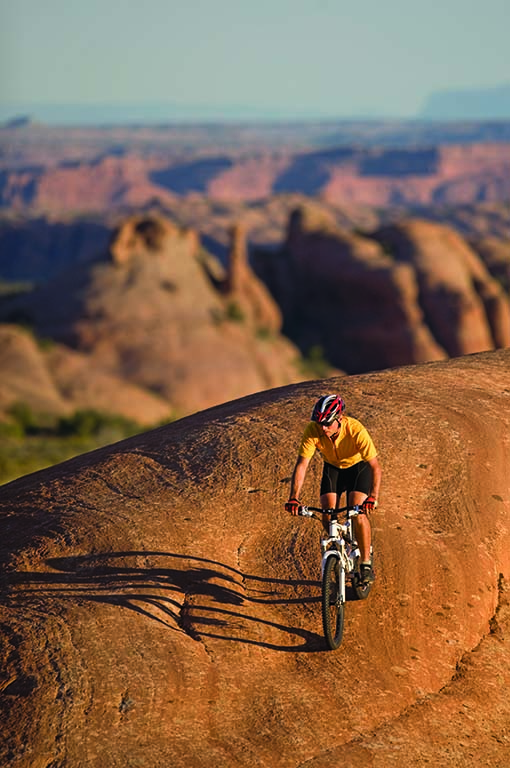 A mountain biker conquers Slickrock Trail at Sand Flats Recreation Area. Photo courtesy of iStock.