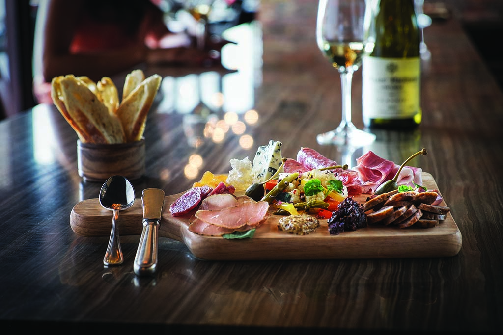 Cocktail hour calls for charcuterie and wine at Enchantment. Photo by Mark W. Lipczynski.