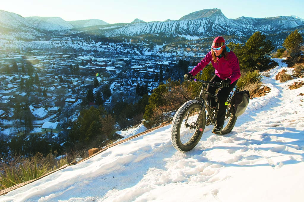 Fat tire biking is even better with a view of Durango. Photo by Keenan Harvey.
