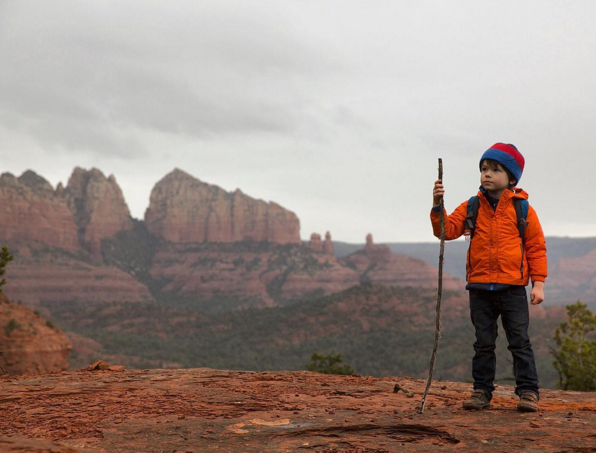 Six-year-old @hawkeyehuey looking for undiscovered vortices near Sedona. Photo by @natgeotravel.