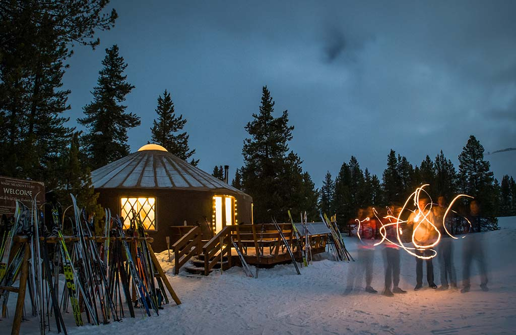 Cross-country skis or snowshoes are the preferred mode of transportation to the Magic Meadows Yurt. Photo by Xavier Fane.