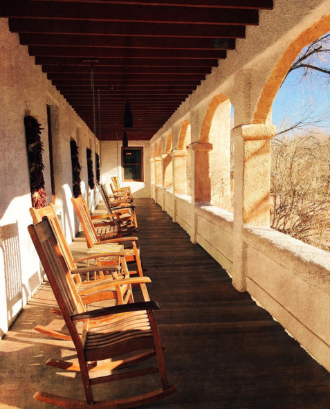 Where we'd like to be every morning: the porch at Ojo Caliente. Photo by Dawn Chandler.