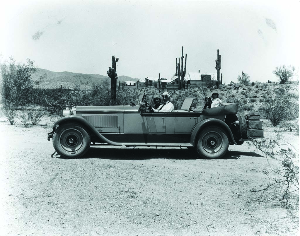 "Wright and family survey the ""Ocatilla"" Desert Camp. Image courtesy of the Frank Lloyd Wright Foundation."