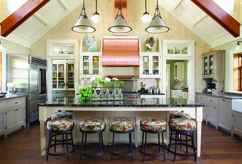 The large kitchen features a copper range hood and tongue-and-groove walls.