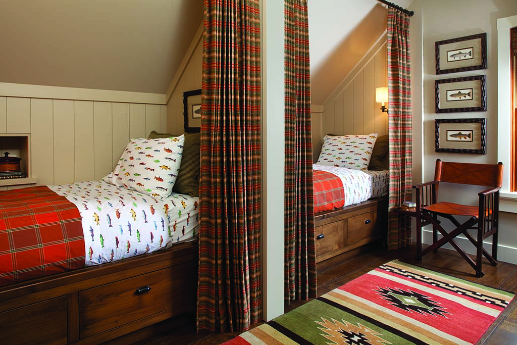 Custom train-car style bunks in the attic above the fly-fishing tackle room easily accommodate extra guests.