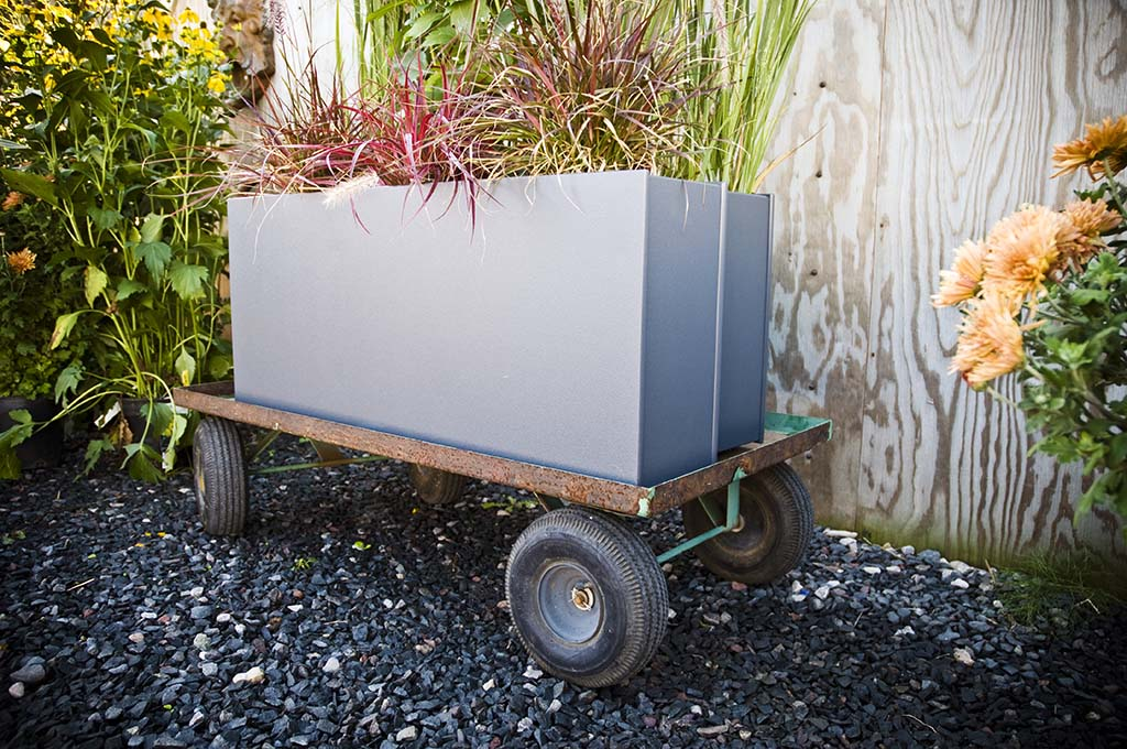 Loll Designs' outdoor planters come in a variety of sizes, shapes and colors, lending a touch of modern design to any garden.