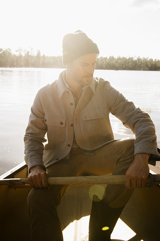 On him: Shirt jacket by Woolrich. Canvas jeans by Faherty, available at Stag Provisions. Beanie by Under Armour, available at Cabela's.