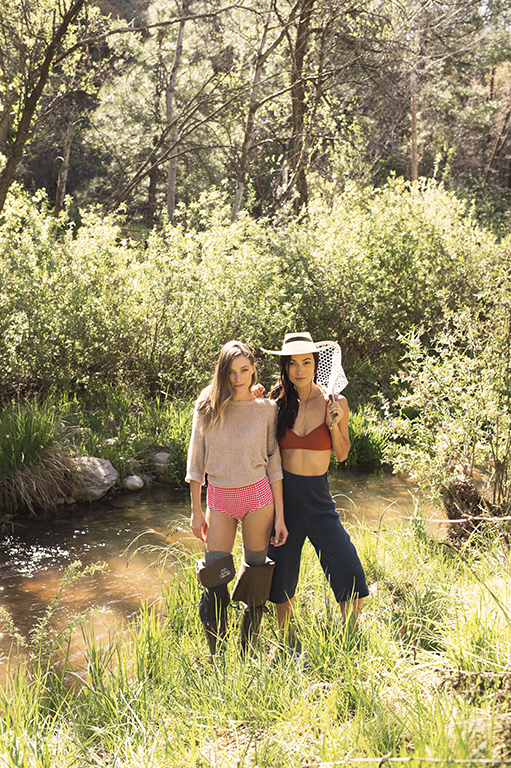 Left: Sweater by Demylee Rina, available at Kick Pleat. Bikini bottoms by J.Crew. Waders available at Cabela's. Right: Bikini top by Rachel Comey, and pants by Lauren Manoogian, both avialable at Kickpleat. Vintage hat, available at Feathers. Wooden hand fishnet by Filson.