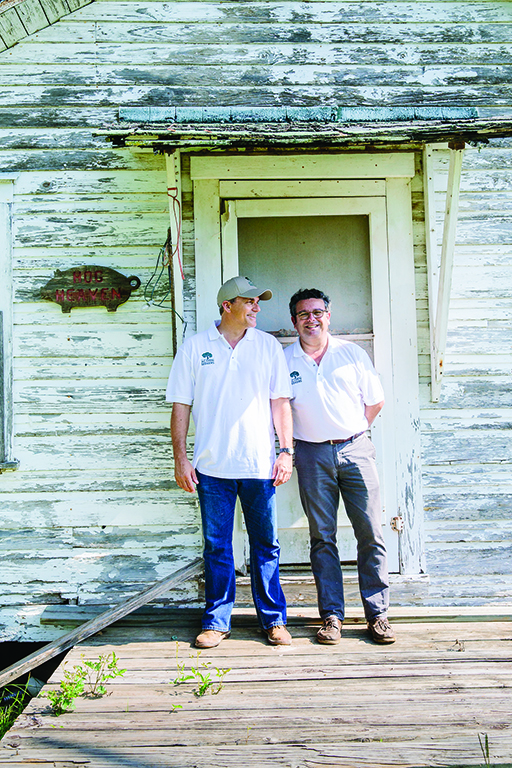 Sergio Marsal and Manuel Murga are giving traditional Spanish jamón a Texas makeover at Acornseekers in Flatonia, where pigs graze on acorns all day, producing a deliciously original ham. Photo by Wynn Myers.