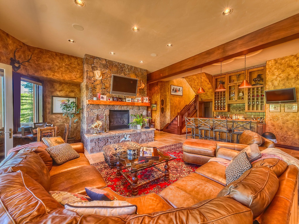 Designed with family and friends of all ages in mind, the entertainment room boasts a fireplace, bar, large ara for seating and multiple televisions and easy access to the game room and downstairs guest quarters.