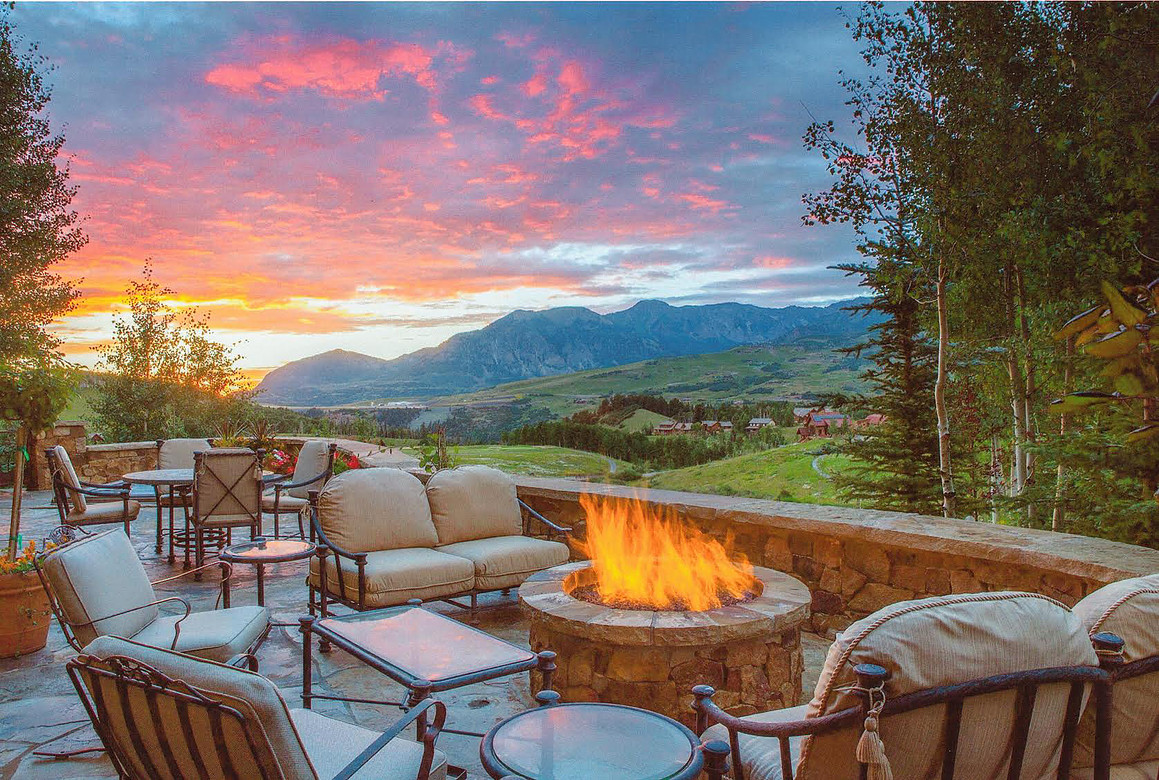 With the San Sophias as your backdrop, this outdoor space is one of the largest patio spaces in Mountain Village. Enjoy your 1.34 acres and multiple levels of lawn from this large patio, anchored by a beautiful stone fire pit and built-in grill.