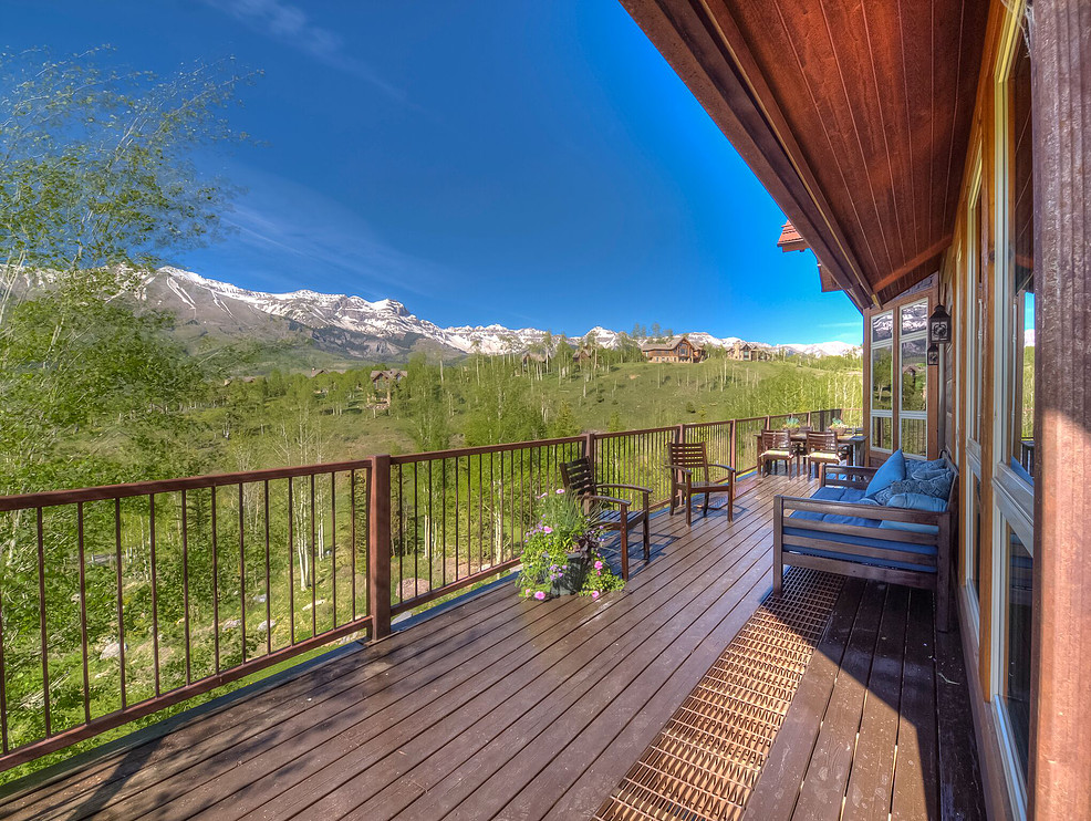 The main floor deck runs the length of the house, overlooking the majestic San Sophia Mountains in the background and 99 Pennington's trees with exterior lighting in the foreground. Perfect postcard views meet a sense of privacy.