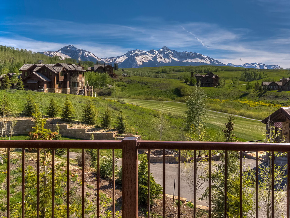 The third-floor bunk room balcony offers another vantage point of the area ski slopes and golf course.