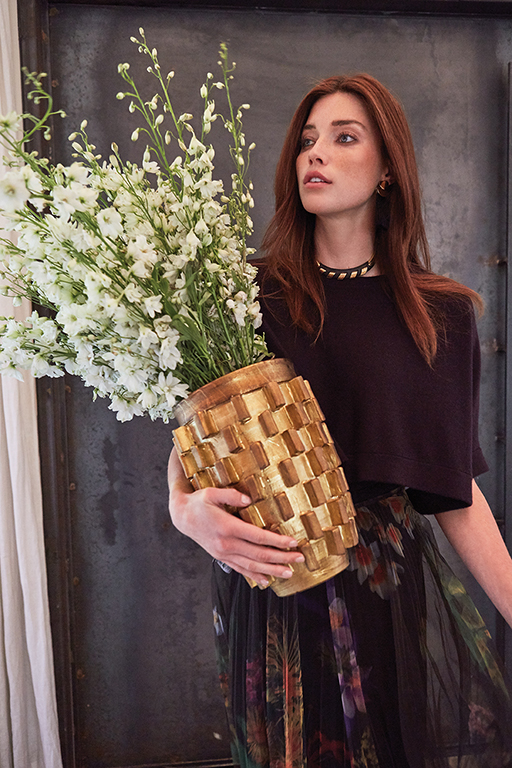 Top by Brunello Cucinelli, available at Neiman Marcus, Dallas. Skirt by Cédric Charlier, available at TTH Forty Five Ten, Dallas. Earrings by Lizzie Fortunato, available at Elements, Dallas. Vintage Lanvin necklace, stylist's own. Vase available at GRO Designs, Dallas.