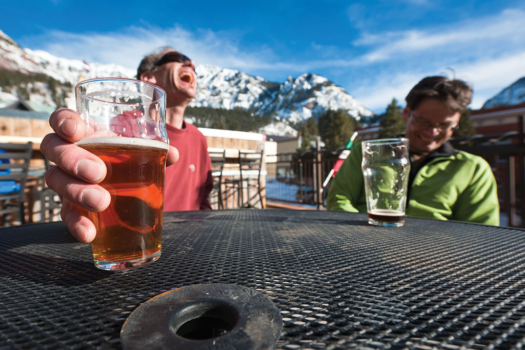 Thorsten Schwander and Casey Shaw enjoying a brew at the Ouray Brewery after a long day of ice climbing in the Ouray Ice Park in Ouray, Colorado.